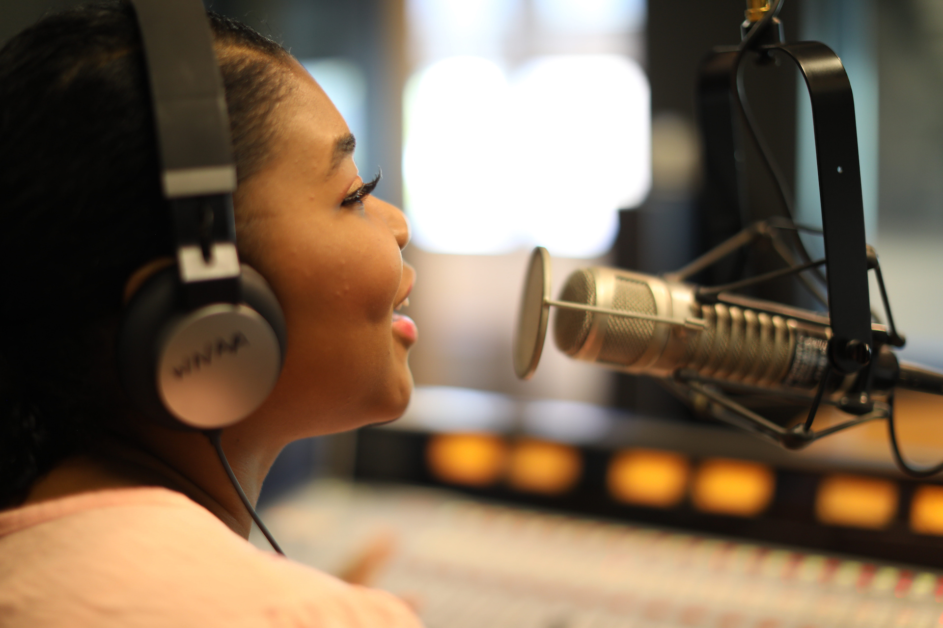 Young African American Woman Speaking into Microphone