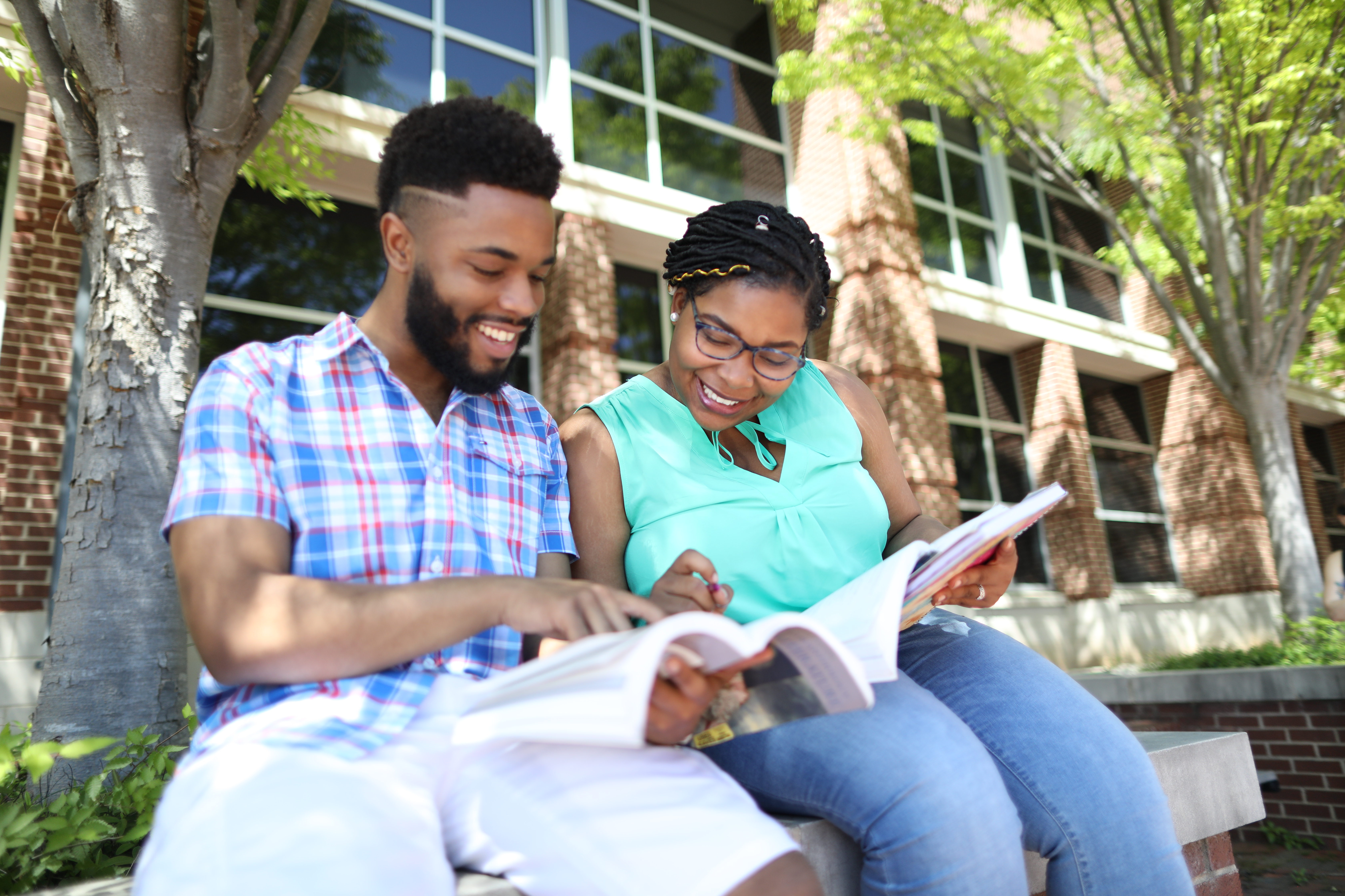 two nc a&T students studying outside