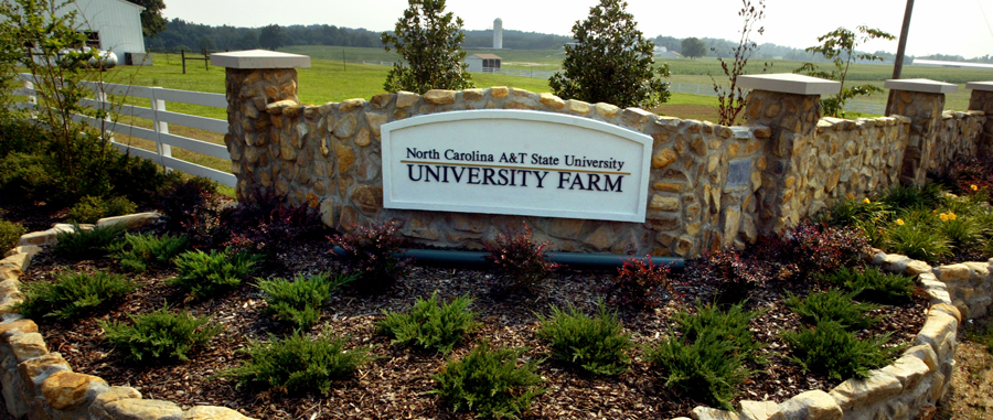 a sign at the entrance to the a and t university farm