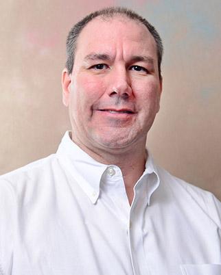 Mark L. Burkey