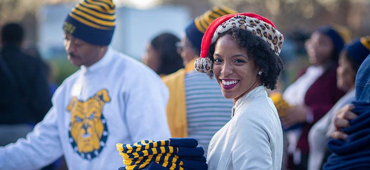 Female A&T employee wearing beanie