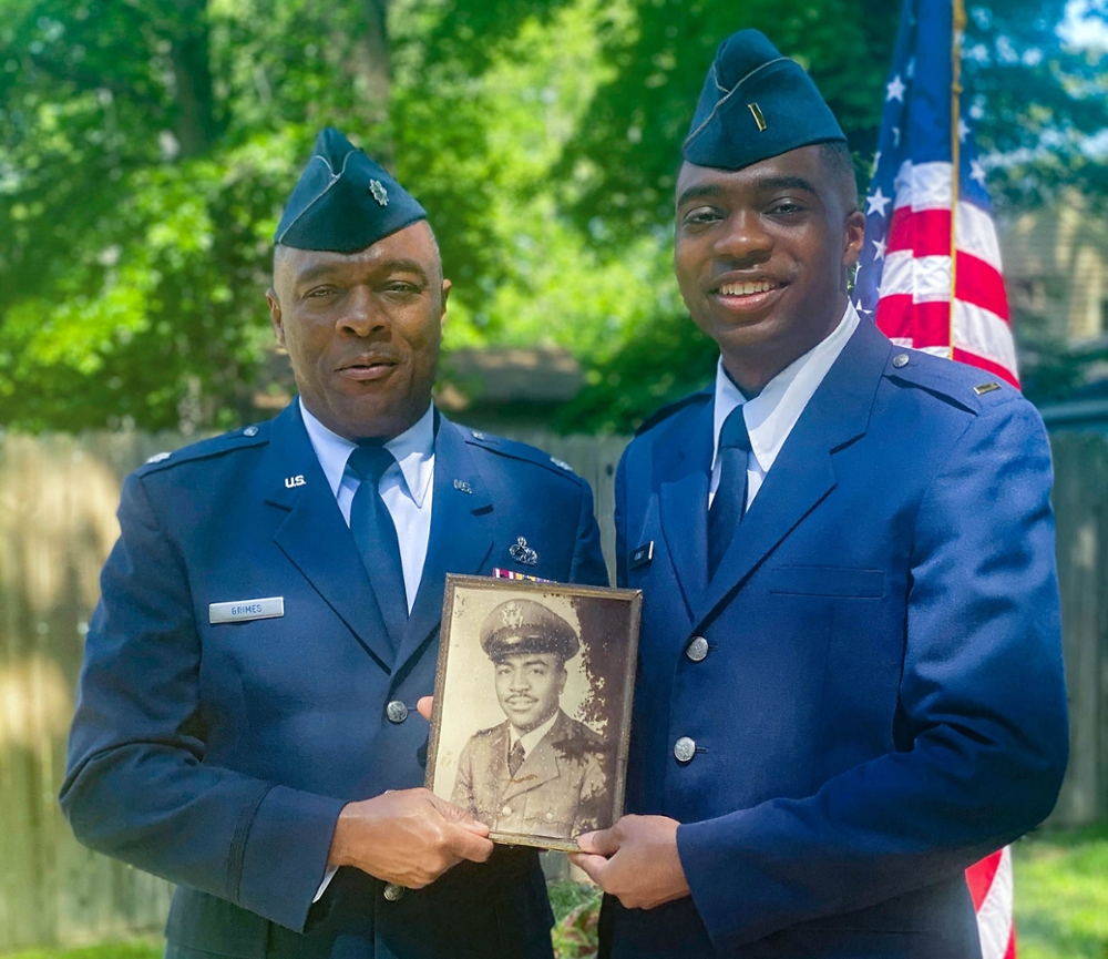 Aggie alums Retired Lt. Col. Grimes and son Second Lt. Grimes hold photo of grandfather also an Aggie Air Force alum