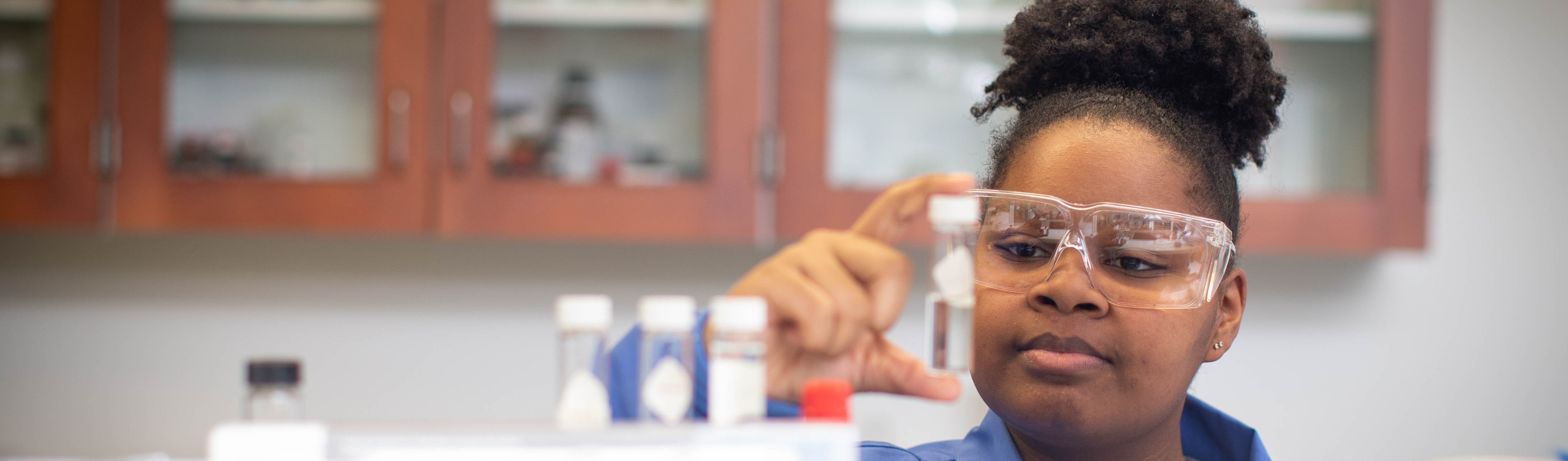 This is a photo of a student in a laboratory setting.